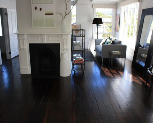 Stained floorboards in living room